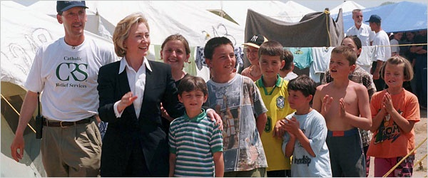 Edward P. Joseph and Hillary Rodham Clinton near the border of Kosovo and Macedonia in 1999. Stenkovec-I Refugee Camp, Catholic Relief Services