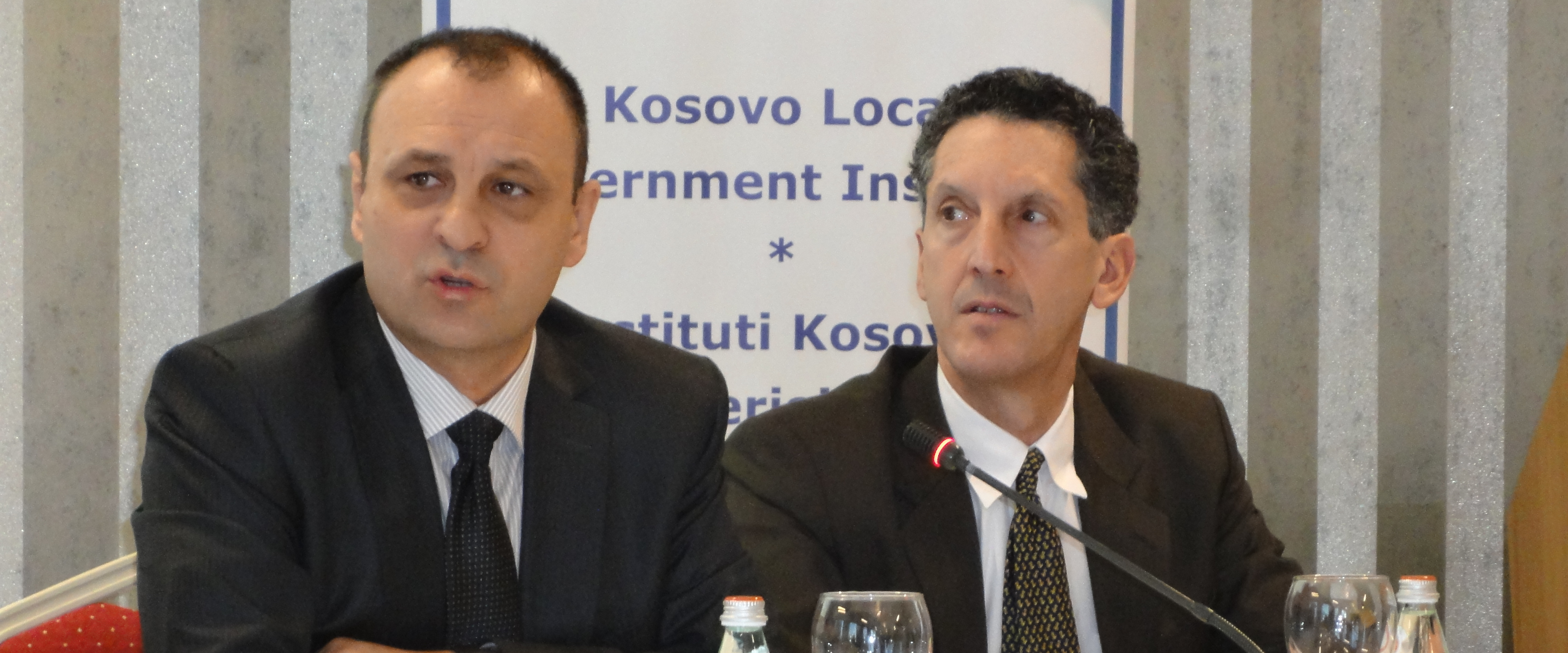 Edward P. Joseph seated next to Slobodan Petrovic, Deputy Prime Minister of Kosovo.